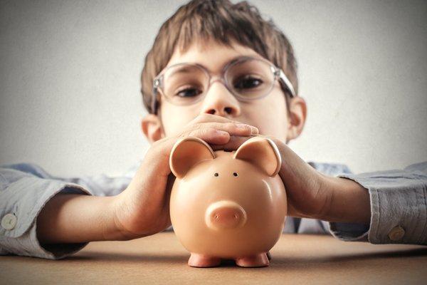 600 boy piggy bank savings shutterstock_244863028