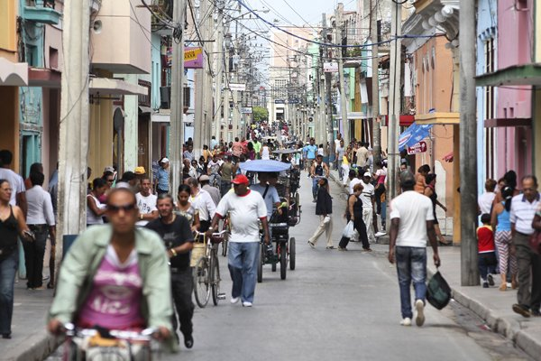 CAMAGUEY, CUBA - FEBRUARY 17, 2011: Crowds of people walk in Camaguey, Cuba. Camaguey is the 3rd largest city in Cuba (321,000 people) and its Old Town is a UNESCO World Heritage Site.