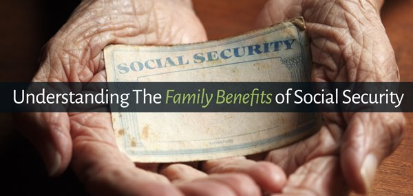 Close up of Aging female hands holding Social Security card.