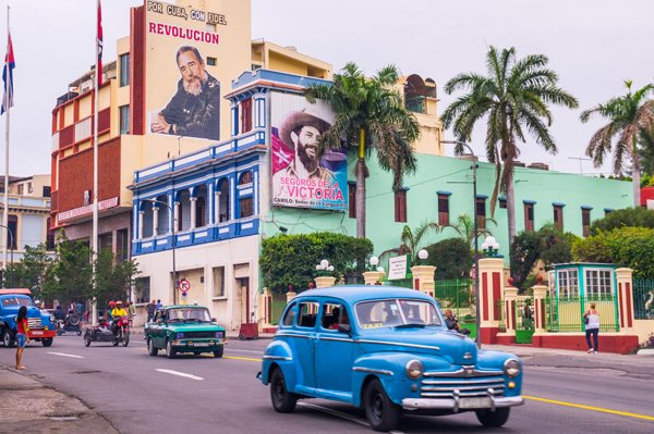 Santiago de Cuba, Cuba - January 4, 2016: Santiago de Cuba is often referred to as birthplace of the Cuban revolucion. Posters of Fidel Castro advertise the revolution