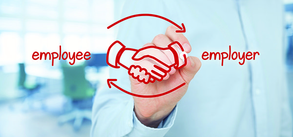 employee and employer shaking hands