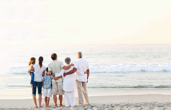 Multigenerational family photo at the beach
